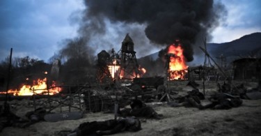 conan-2011-burning-village-dead-bodies-01